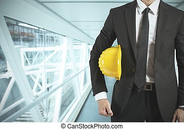 Architect - Ready businessman architect with yellow helmet