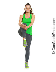 Happy healthy young woman stretching