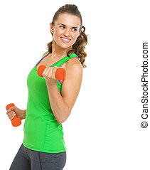 Happy fitness young woman making exercise with dumbbells and...