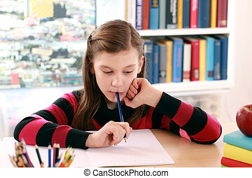 Little girl doing her school homework at a desk