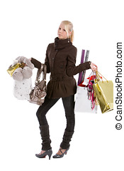 Too much shopping - Young blond teenage girl with loads of...