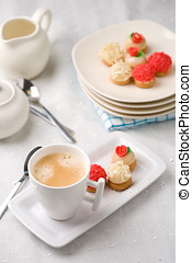 Cup of coffee with treats - Small cup of fresh coffee with...
