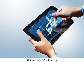 Dna strand On The Tablet Screen - DNA helix abstract...