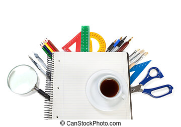 A set of office tools on the notebook for notes and a cup of...