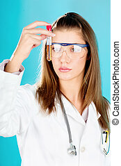young woman looking at the chemical tube