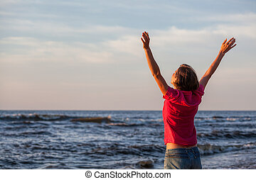 Freedom - Young woman spending time at sunny seaside