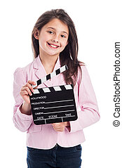 Smiling Young Girl with Clapperboard. - Beautiful young...
