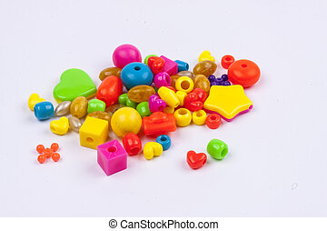 Colourful beads - white background. - Colourful beads on...