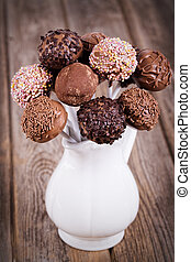 Cake pops - Homemade chocolate cake pops in a white jug....