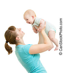 loving mother having fun with baby boy isolated on white