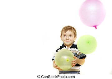 happy boy with colorful balloons over white