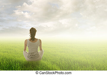 woman sit on grassland - Woman of brunet hair sit on...