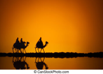 Three wise men on the way to Jesus in Bethlehem