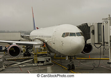 Unloading Jet - A commercial jet at the gate in a busy...