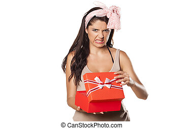 bad gift - pretty girl is not happy and is disgusted her...
