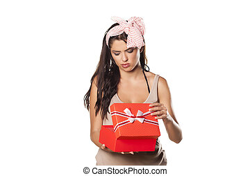 bad gift - pretty girl is not happy for her gifts