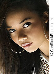 Young woman portrait - Filipino young adult woman looking at...