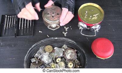 clockmaker repairing old clock