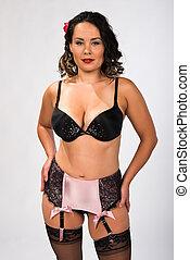 Brunette - Shapely multiracial brunette dressed in vintage...