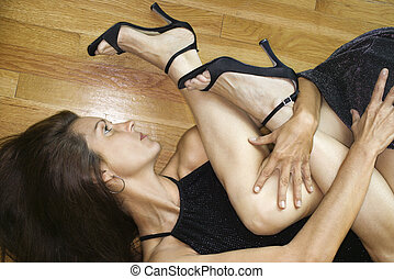 Two females intertwined. - Caucasian mid adult woman lying...