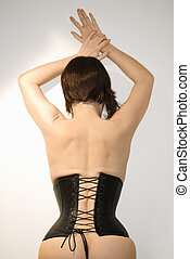 Woman wearing corset. - Rear view portrait of young...