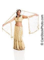 young woman in sari dancing
