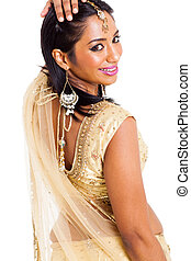 indian woman looking over her shoulder - beautiful indian...