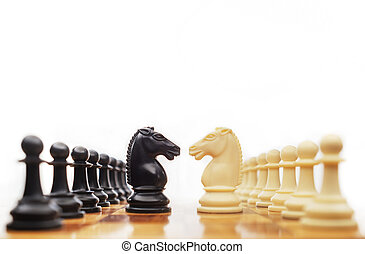 Chess conflict - Chess horses facing each other for a...