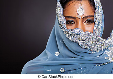 indian woman in sari with her face covered - young indian...