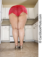 Woman in lingerie - Back view of full figured Caucasian...