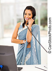 indian office worker talking on the phone - beautiful indian...