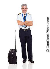 middle aged airline pilot with arms crossed - smiling middle...