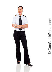 female young airline co-pilot with arms crossed - beautiful...