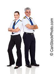 senior pilot and female co-pilot full length portrait on...