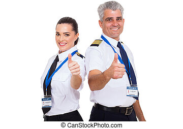 airline pilots giving thumbs up