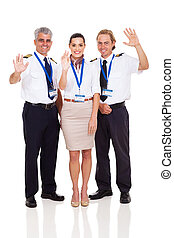 pilots and airhostess waving - cheerful airline pilots and...