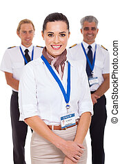 airhostess and pilots - attractive airhostess standing in...