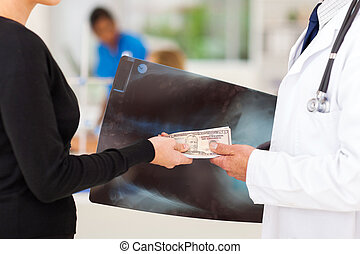 medical sales rep bribing a doctor - doctor receiving a...
