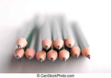 Stack of sharpened pencils, shallow focus on front center...