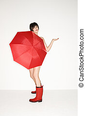 Woman with umbrella - Young sexy Caucasian woman in red...