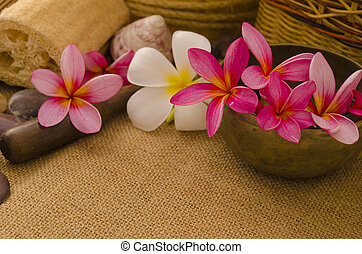tropical spa setup with traditional frangipani flower and...