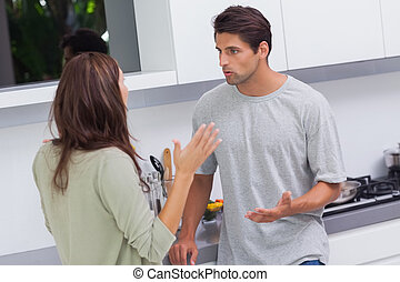 Couple arguing in the kitchen - Young couple arguing in the...