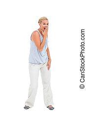 Surprised blonde woman gesturing
