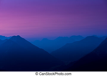 silhouette of tyrol mountains at sunrise