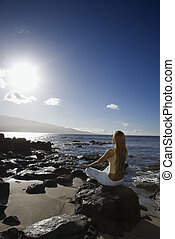 Woman meditating - Young adult Asian Filipino female...