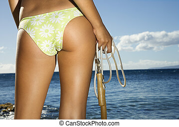 Woman on Maui beach - Close up of derriere of Asian Filipino...