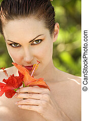 Woman with flowers. - Attractive bare smiling Caucasian...