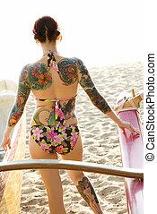 Woman on beach. - Sexy redheaded Caucasian woman in bikini...