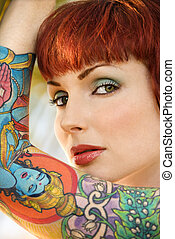 Attractive tattooed woman. - Close up portrait of attractive...