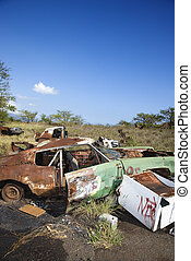 Rusty car in junkyard - Old rusted car in junkyard